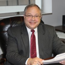 Attorney Stan Butterfield sitting at his desk